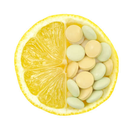 drugs pills: Close up of lemon and pills isolated – vitamin concept - vitamin c Stock Photo