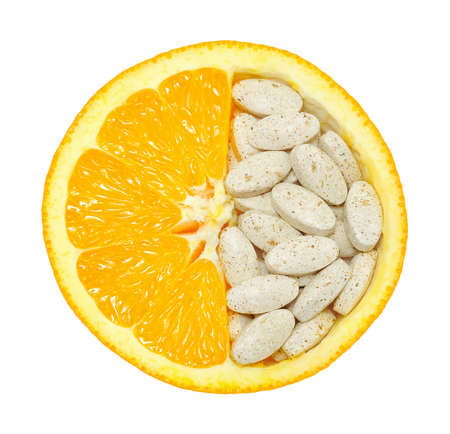 nutritional supplement: Close up of orange and pills isolated - vitamin concept Stock Photo