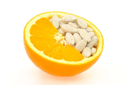 Close up of orange and pills isolated - vitamin concept Standard-Bild