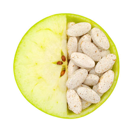 Close up of apple and pills isolated - vitamin concept photo