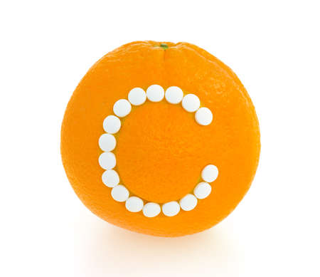 Orange with vitamin c pills over white background - concept Stock Photo - 12576725