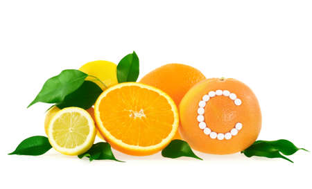 Orange, lemon, grapefruit with vitamin c pills over white background � citrus fruits concept photo