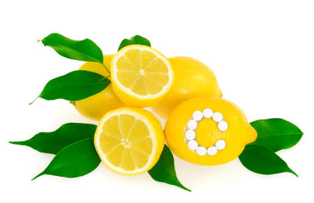 Lemons with vitamin c pills over white background –concept photo