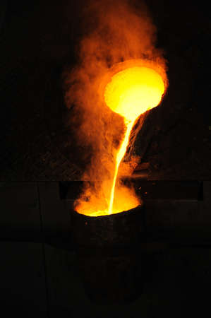 cast: Foundry - molten metal poured from ladle for casting