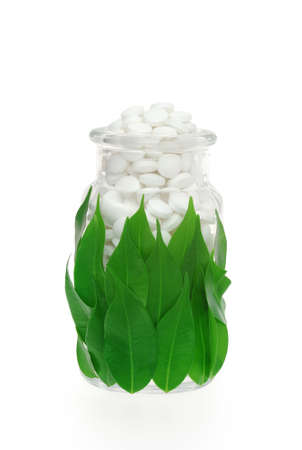 Herbal supplement pills in pill bottle � alternative medicine concept photo