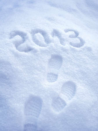 Foot step print in snow � New Year 2013 concept photo