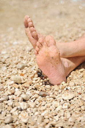 feet in sand: Relaxation on beach, detail of male feet Stock Photo