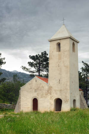 St Peters Church, medieval church situated on the Adriatic highway between Starigrad and Seline, Starigrad - Paklenica, Croatia photo