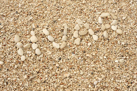HVAR word made of pebbles, authentic picture of Hvar's beach photo