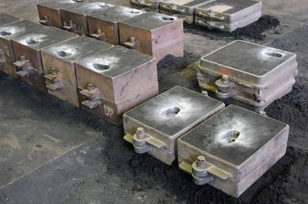steelworks: Foundry, sand molded casting, molding flasks Stock Photo