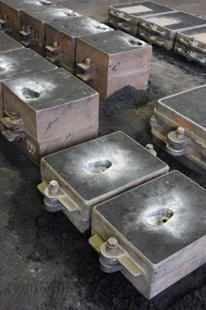 ferrous foundry: Foundry, sand molded casting, molding flasks Stock Photo