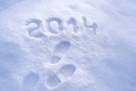 Foot step prints in snow, New Year 2014 concept Stock Photo