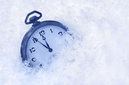 12 o'clock: Pocket watch in snow, Happy New Year greeting card