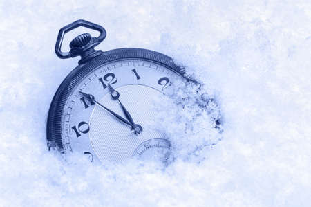 Pocket watch in snow, Happy New Year greeting card photo