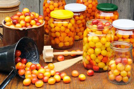 Preserving Mirabelle plums - jars of homemade fruit preserves - Mirabelle prune Stock Photo