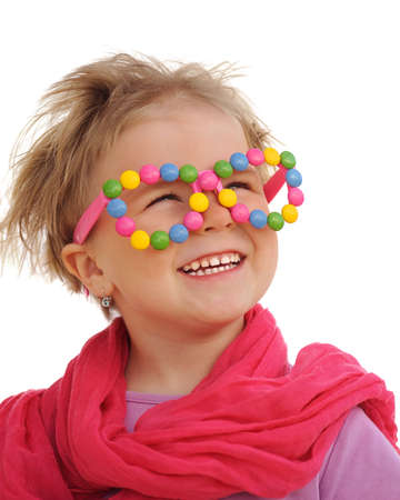 4 5 year old: Portrait of cute little girl wearing funny glasses, decorated with colorful sweets, smarties, candies