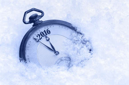 12 o'clock: Pocket watch in snow, New Year 2016 greeting card