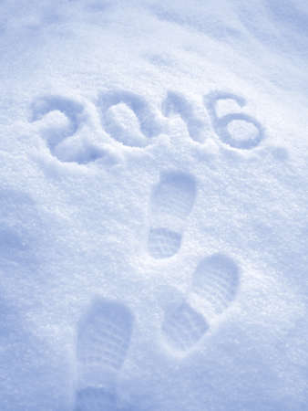 new idea: Happy New Year 2016 greeting, foot step prints in snow