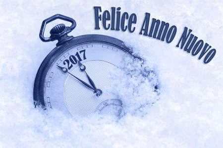 snow field: New Year 2017 greeting in Italian language, Felice Anno Nuovo text, 2017 greeting, happy new year Stock Photo