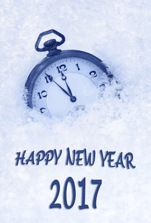 one year old: 2017 New Year greeting card  in English language, pocket watch in snow, 2017 new year