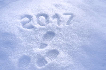 new beginning: New Year 2017 greeting, footprints in snow, new year 2017, 2017 greeting card