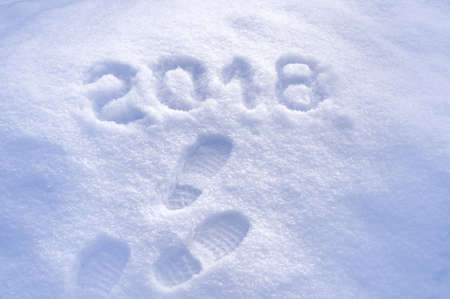 New Year 2018 greeting, footprints in snow, new year 2018, greeting card Фото со стока
