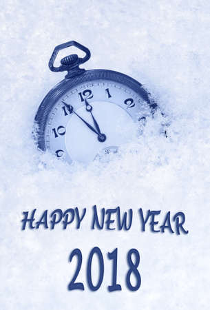 2018 New Year greeting card  in English language, pocket watch in snow