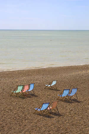 deck chairs: Colorful chairs on Brighton Beach, England  Stock Photo