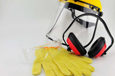 Safety gloves, safety Goggle , Helmet and earmuffs photo