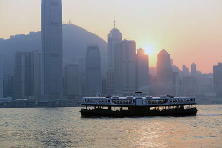 ferryboat: Ferryboat and Hong Kong Victoria Harbour sunset view Stock Photo