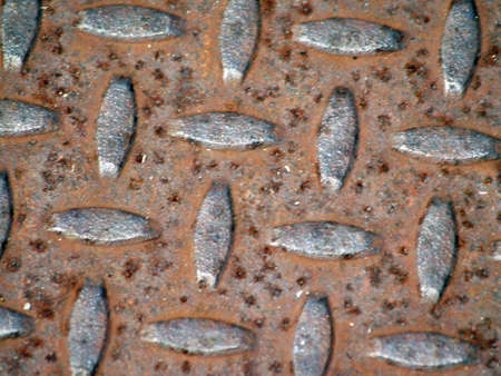traction: rusted metal grate pattern         Stock Photo