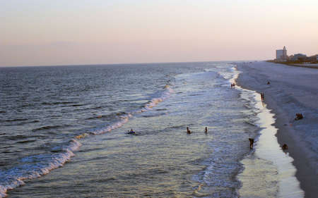 waders: beach at sunset