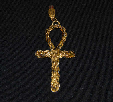 gold cross: gold cross on a black background