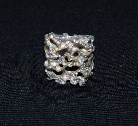 silver jewelry: silver nugget ring on a black background
