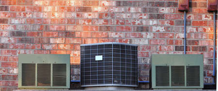 residential air conditioners on a brick background