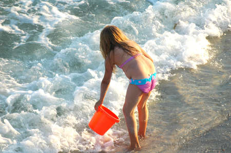 young girl playing in the surf