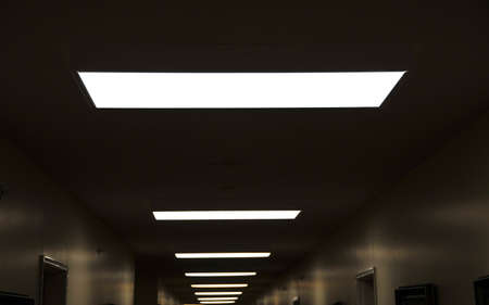 skylights in a dark hallway