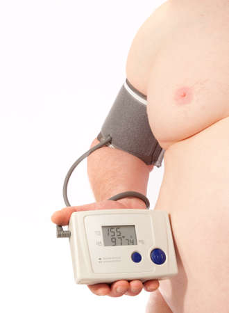 own blood: Overweight man taking his own blood pressure. Stock Photo
