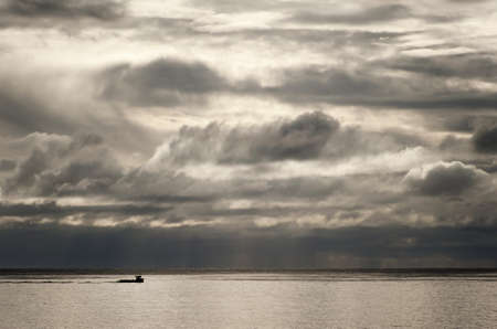 Fishing boat against a dramatic sky over the North Sea in Scotland.