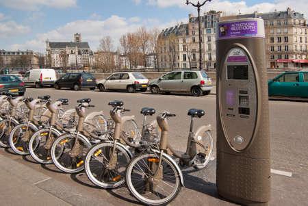 A row of Velib bicycles on a Paris street.