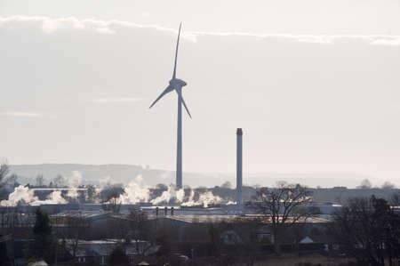 Giant wind turbine in an urbanindustrial setting Stock Photo