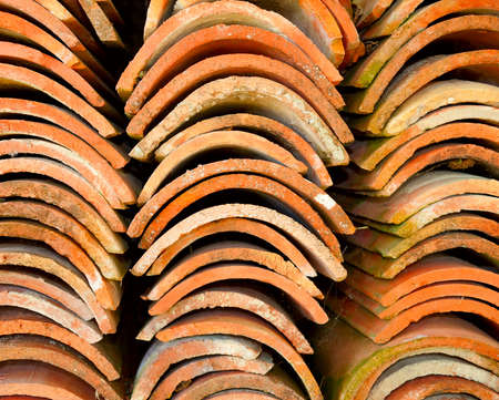 Stacks of red terracotta roof tiles. Stock Photo