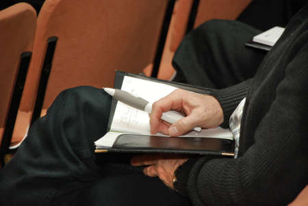 Hands taking notes Stock Photo