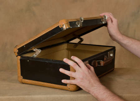 opens: The man opens the suitcase Stock Photo