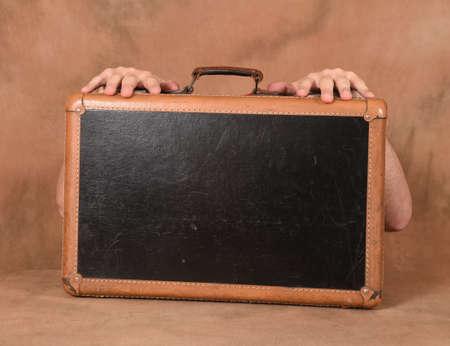 wonderment: Man holding a suitcase