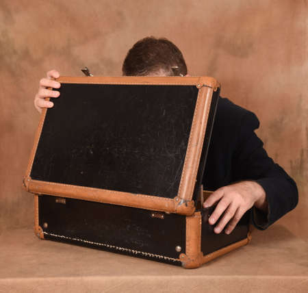 wonderment: The man opens the suitcase Stock Photo