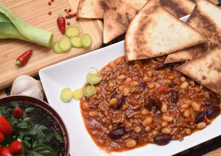 Chilli con carne with pepper, garlicsr and tortillas