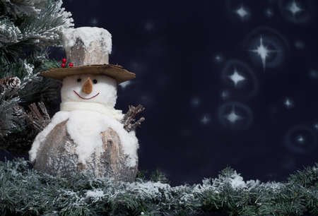 season greetings: Snowman next to Christmas tree Stock Photo