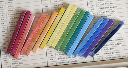 Rainbow color oil chalks in box Stock Photo