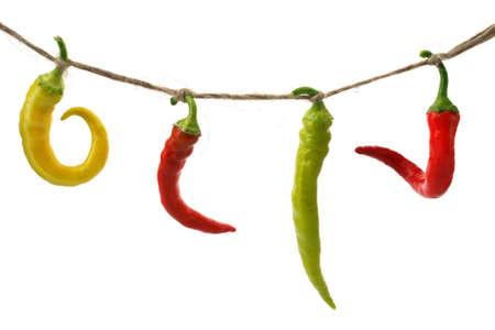 burning pepper chili on rope isolated white background photo